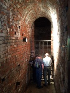 Two people stood in a brick tunnel