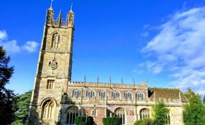 Blue sky, large church and trees