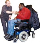 carer helping person in wheelchair