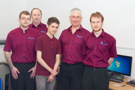 Pictured l-r: Employees Tom Ashman, Andy Cordey, Jack Bowie (work experience), MD John Williams and Matt Brooks of atchway-based IT company Absolutely PC