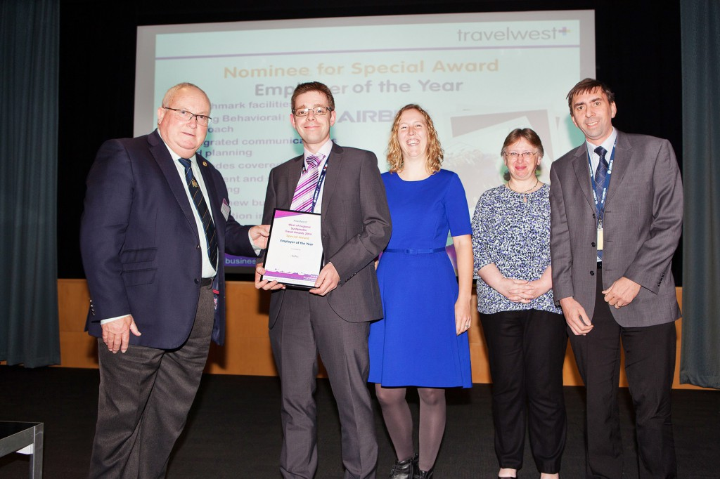 Cllr Brian Allinson presenting the 'employer of the year' award to representatives from Airbus