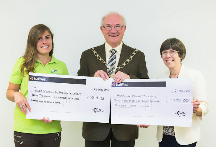 More money came in after the cheques were written which will be donated to the outgoing Chair's chosen charities but Ella at GWAAC is pictured (left) receiving a cheque for £3,519.33 and Maggie Maclean is pictured (right) receiving a cheque for £1,800 for the school support group.