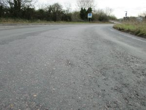 A403 Coast Road before the works looking worn and damaged