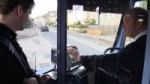 A young person getting on a bus