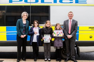 Cllr Claire Young, the competition winning pupils Anna Tilsley, Abi Clemmet and Tallulah Kelly, and St Chad's headteacher Darren Brown.