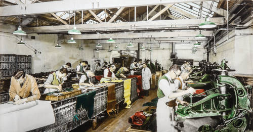 A hand tinted photograph of boot and shoe manufacturing
