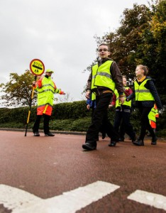 Young children with a school crossing patrol