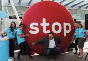 The SmokeFree team with comedian Chris Purchase and a giant red balloon with the word stop on it.