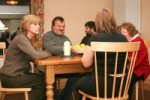 Family around dining table