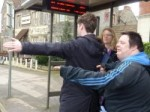 signalling for a bus to stop